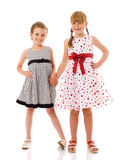 Happy little sisters. Two happy sisters standing together Stock Photos