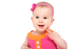 Happy Little Sly Baby Girl In Bright Multicolored Festive Dress Royalty Free Stock Photography
