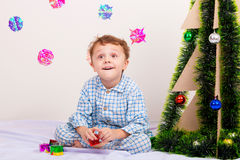 Happy little smiling boy with christmas gift box. Stock Photography
