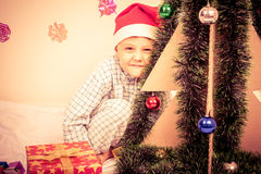 Happy little smiling boy with christmas gift box. Royalty Free Stock Photo