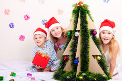 Happy little smiling boy and girls with christmas hat. Stock Photo