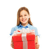 Happy little smiling girl with big present Royalty Free Stock Image