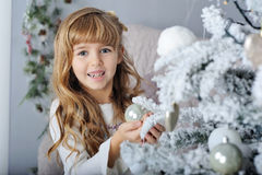 Happy little smiling girl with Christmas ball Royalty Free Stock Image