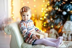 Happy little smiling girl with christmas gift box. royalty free stock images