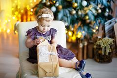 Happy little smiling girl with christmas gift box. royalty free stock photography