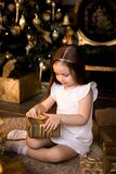 Little smiling girl with christmas gift box. Stock Photo