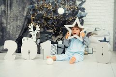 Happy little star. New Year 2018, Christmas. Smiling funny two year old baby girl. Happy little star. New Year 2018, Christmas. Smiling funny two year old baby Royalty Free Stock Photo