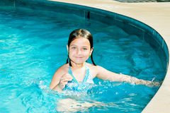Happy Little Swimmer in Pool stock images