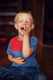 Happy little toddler boy eat berry Royalty Free Stock Photos