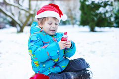 Happy little toddler boy waiting for Christmas santa hat Royalty Free Stock Images