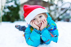 Happy little toddler boy waiting for Christmas santa hat Stock Photos