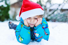 Happy little toddler boy waiting for Christmas santa hat Stock Photography