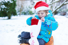 Happy little toddler boy waiting for Christmas santa hat Royalty Free Stock Image