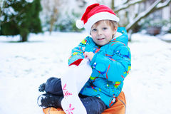 Happy little toddler boy waiting for Christmas santa hat Stock Image