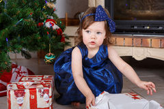 Happy little toddler girl with Christmas presents Royalty Free Stock Image