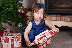 Happy little toddler girl with Christmas presents Stock Photos