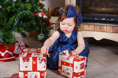 Happy little toddler girl with Christmas presents Stock Image