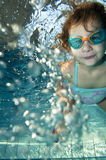 Happy little toddler girl swimming underwater. Happy little toddler girl playing underwater in swimming pool Stock Photography