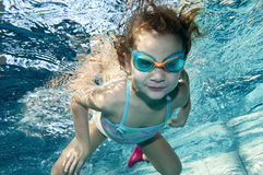 Happy little toddler girl underwater Stock Image