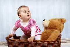 Happy little toddler laughing in the basket Royalty Free Stock Images
