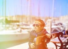 Happy little tourist in european harbor Stock Photo