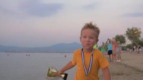 Happy little winner running with trophy stock video