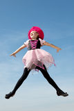 Happy Little Witch Jumping Flying at the Blue Sky Stock Photos