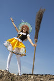 Happy Little Witch Standing with a Broom Royalty Free Stock Photography