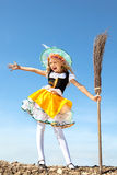 Happy Little Witch Standing with a Broom Royalty Free Stock Images