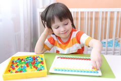 Happy little 3 years boy with mosaic Stock Photography
