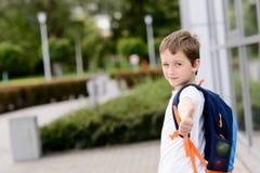 Happy little 7 years schoolboy going to school. Stock Photos