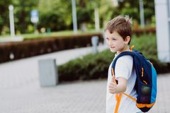 Happy little 7 years schoolboy going to school. Royalty Free Stock Photos