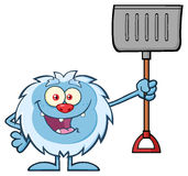 Happy Little Yeti Cartoon Character Holding Up A Winter Shovel Royalty Free Stock Images
