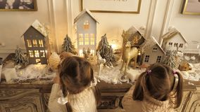 Happy llittle pretty girls with Christmas and New Year toys and decorations. Professional shot in 4K resolution. 015. You can use it e.g. in your christmas royalty free stock photos