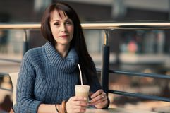 Happy woman drinking coffee in cafe Stock Photo