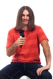 Happy long haired man with hair trimmer Royalty Free Stock Photography