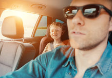 Happy long journey in car with father Stock Photography