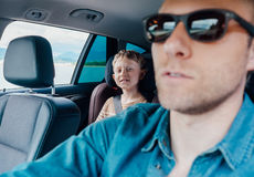 Happy long journey in car with father Stock Photos