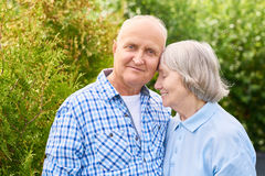 Happy  Long Marriage. Portrait of loving senior couple embracing tenderly posing for camera in beautiful garden Stock Photos