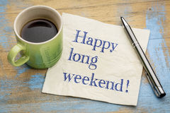 Happy long weekend napkin concept. Happy long weekend  - handwriting on a napkin with a cup of espresso coffee Royalty Free Stock Photography