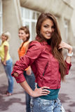 Happy longhaired girl with friends Stock Photos