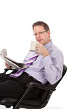 Happy Looking Businessman Reading Newspaper Royalty Free Stock Photography