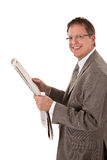 Happy Looking Businessman Reading Newspaper Royalty Free Stock Image