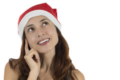 Happy looking Christmas woman thinking and dreaming Royalty Free Stock Photo
