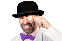 Man with a monocle in his hand. Happy looking man with a monocle in his hand Stock Images