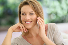Happy looking woman on the phone talking Royalty Free Stock Image