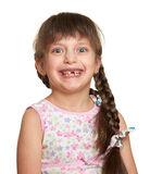 Happy lost tooth girl portrait, studio shoot on white background Royalty Free Stock Photo