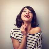 Happy loudly laughing young casual woman looking up. Vintage clo Stock Photography