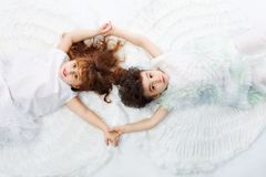 Happy love. Beautiful little angels. Isolated over white background Stock Images