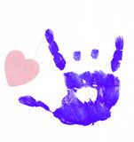 Happy in love. Finger painted hand making rock on sign with heart attached Royalty Free Stock Photo